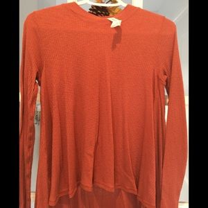Lululemon size 6 top in rust colour NWOT